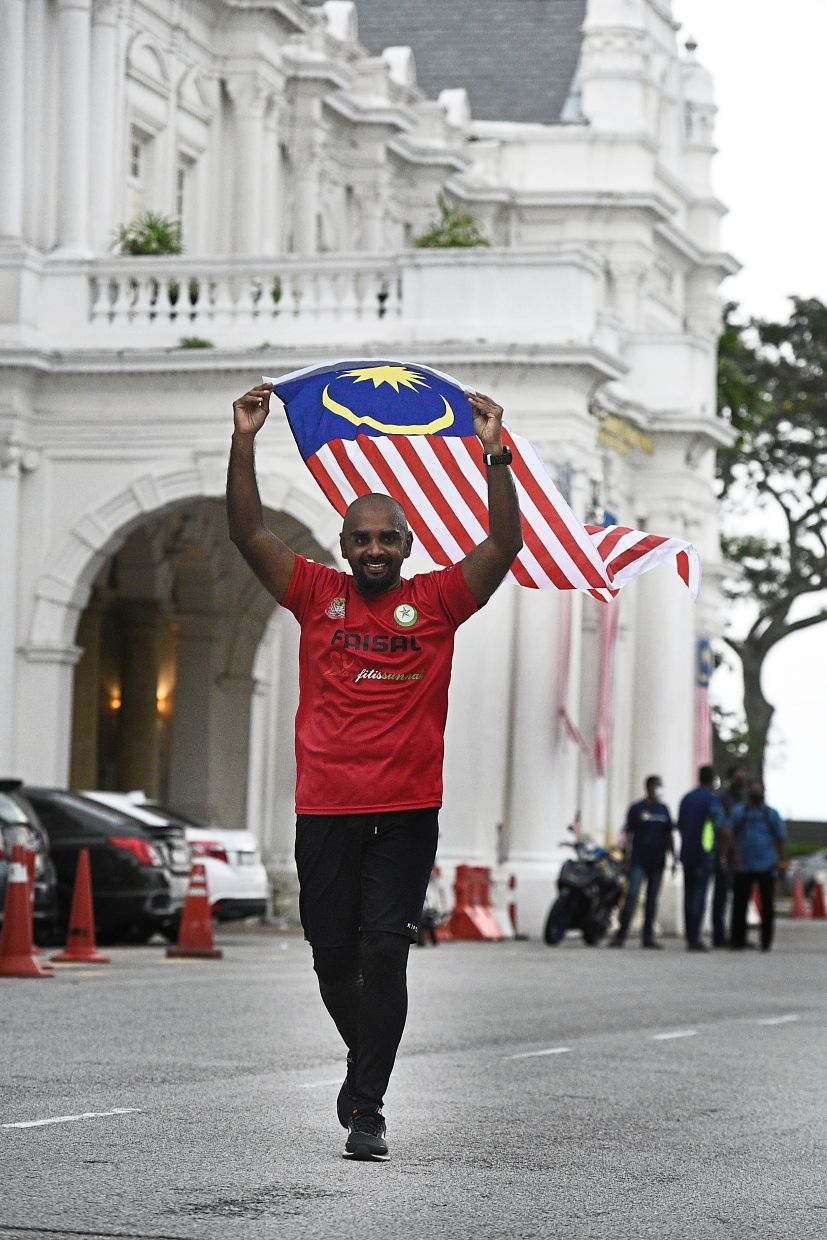 Doing what he does best: Ahmed Faisal has been doing this solo run every Malaysia Day for five years. — KT GOH/The Star