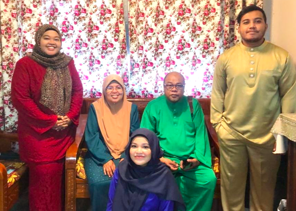 Nur Hidayah (in red) with her family. She says that it was her mother who encouraged her to use her skills and knowledge to start her food business  Photo: Nur Hidayah Jeffri