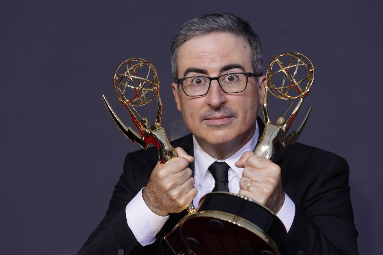 John Oliver with the award for outstanding writing for a variety series and outstanding variety talk series for 'Last Week Tonight with John Oliver'. Photo: AP