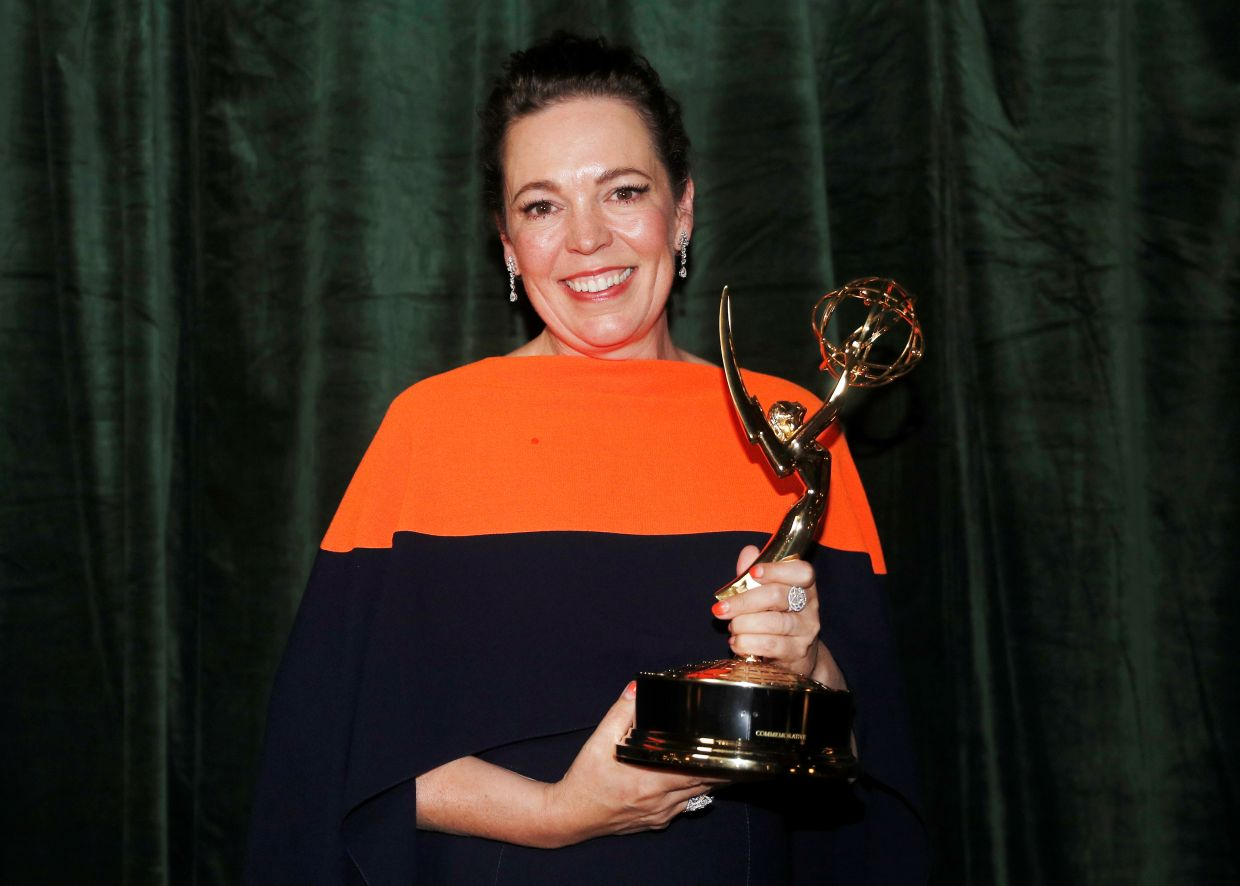Olivia Colman poses with her Emmy award for Outstanding Lead Actress in a Drama Series. Photo: Reuters