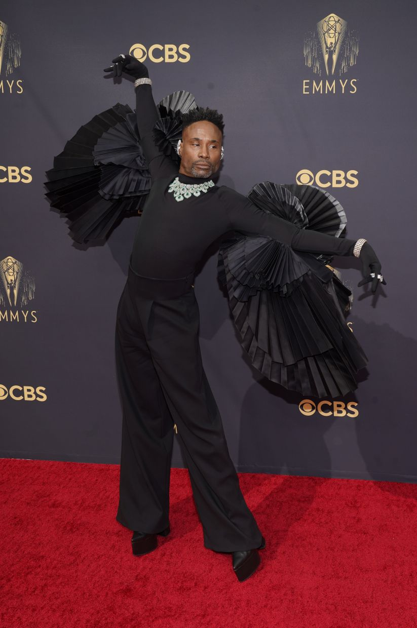 Billy Porter shows off his outfit. Photo: AP