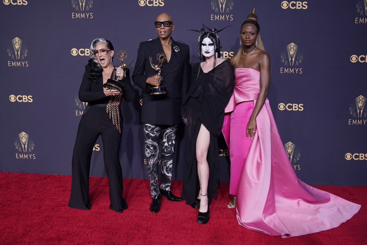 Michelle Visage, from left, RuPaul Charles, Gottmik, and Symone pose for a photo with the award for outstanding competition program for 'RuPaul's Drag Race' at the 73rd Primetime Emmy Awards on Sunday, Sept 19, 2021, at L.A. Live in Los Angeles. Photo: AP