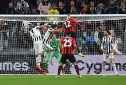 Soccer-Rebic earns Milan late draw at winless Juve
