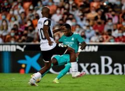 Soccer-Real Madrid stage late comeback to win at Valencia