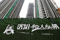 China Evergrande shares hit 11-year low on default risks