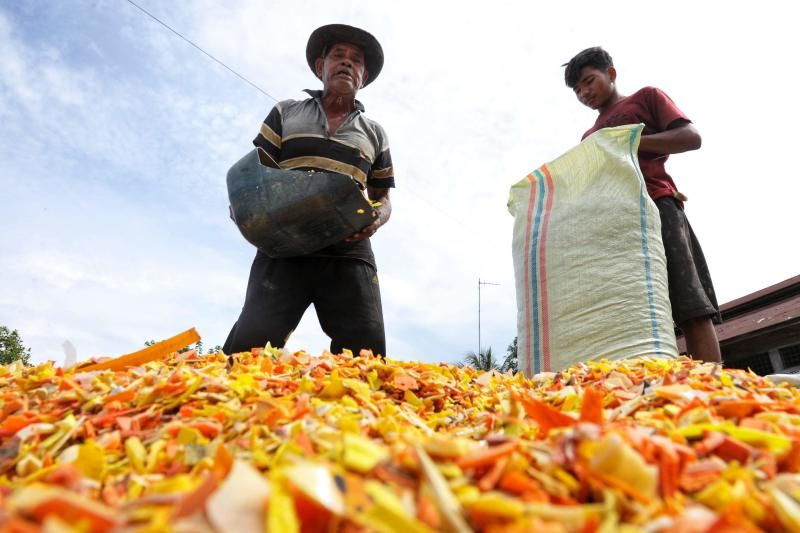 Workers bag recycled plastic pellets, processed from waste collected along coastal areas and to be sold on to other plastic product manufacturers, in Lhokseumawe, Aceh on Monday (Sept 20, 2021). - AFP