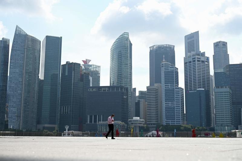A man walking along the promenade at Marina Bay in Singapore on Tuesday (Sept 21). - AFP
