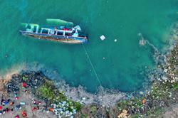 At least 10 killed in river boat tragedy