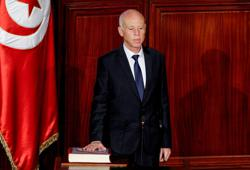 Tunisian president declares transitional rules, new electoral law