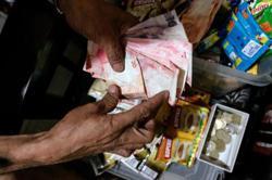 More Philippine households saving, not spending: UK-based think tank