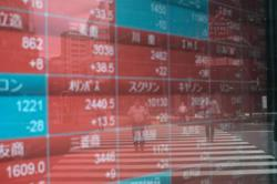 Asian markets stabilise after rout but Evergrande fears linger