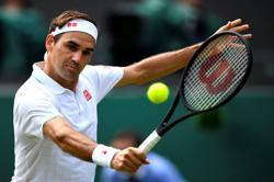 Tennis-Federer says 'feeling strong' after knee surgery