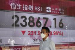 Asian shares mostly extend losses on China property worries