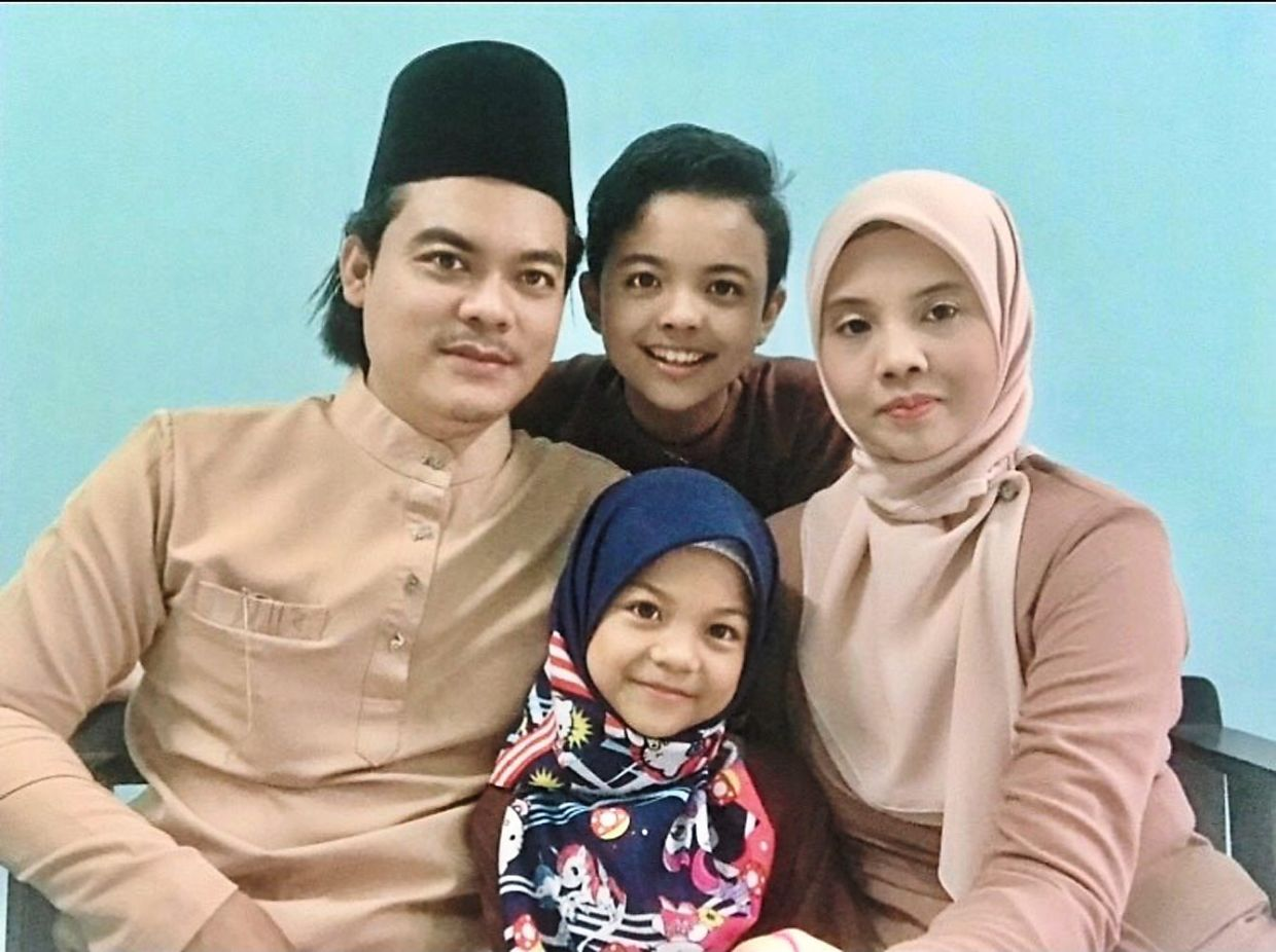 Family support is very important to Mazzaton (pictured with her husband and their two children). Photo: Mazzaton Miza Wahab