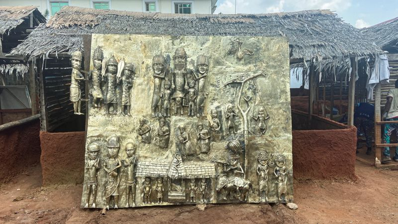 A newly made bronze plaque depicting historical events in West Africas once mighty Kingdom of Benin which is being offered as a gift to the British Museum is seen on display in Benin City Nigeria July 31 2021. REUTERSTife Owolabi