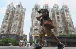 Insight - Are Hong Kong property tycoons China's next target?