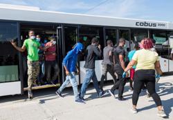 After long trek to U.S., Haitian woman fears husband deported