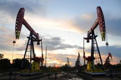 Oil edges up, as investors worry about global demand