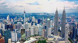 Malaysia tops forecasts for faster growth in 2022