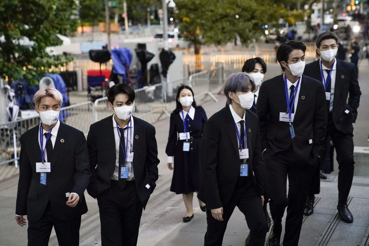 Members of BTS, from left, J-Hope, Jung Kook, Suga, Jimin, partially obscured, Jin and RM arrive to security check-in at United Nations headquarters on Sept 20, 2021, during the 76th Session of the U.N. General Assembly in New York. Photo: AP