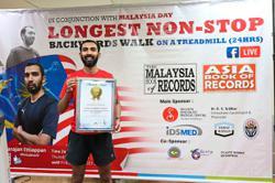 Tireless frontliner Sivarajan 'walks' into Malaysia and Asia Book of Records