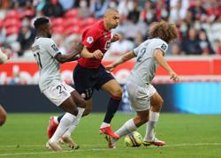 Soccer-Yilmaz inspires Lille to win over Reims