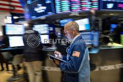 GLOBAL MARKETS-Stocks post gains, dollar strengthens after Fed flags taper soon