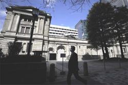 BoJ keeps policy steady, offers bleaker view on exports, output