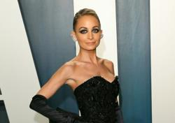 That's hot: Nicole Richie accidentally sets hair on fire at 40th birthday party