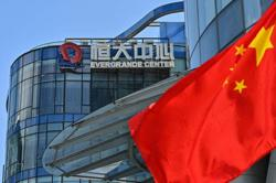 Evergrande chairman seeks to soothe Chinese investors as payment looms