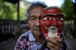 One man's quest to save traditional storytelling 'Awang Batil' from extinction