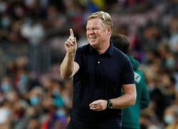 Soccer-Barca chief Laporta offers Koeman backing but wants better football