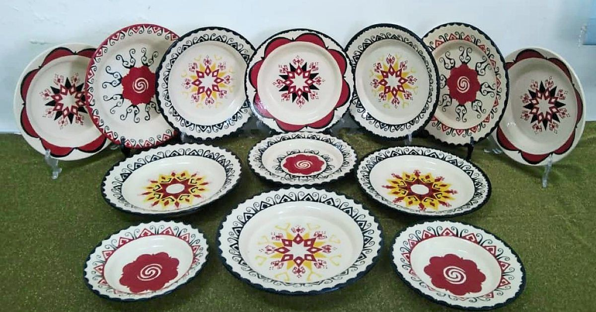 Kalum's plates are decorated with traditional Iban kelingai designs.