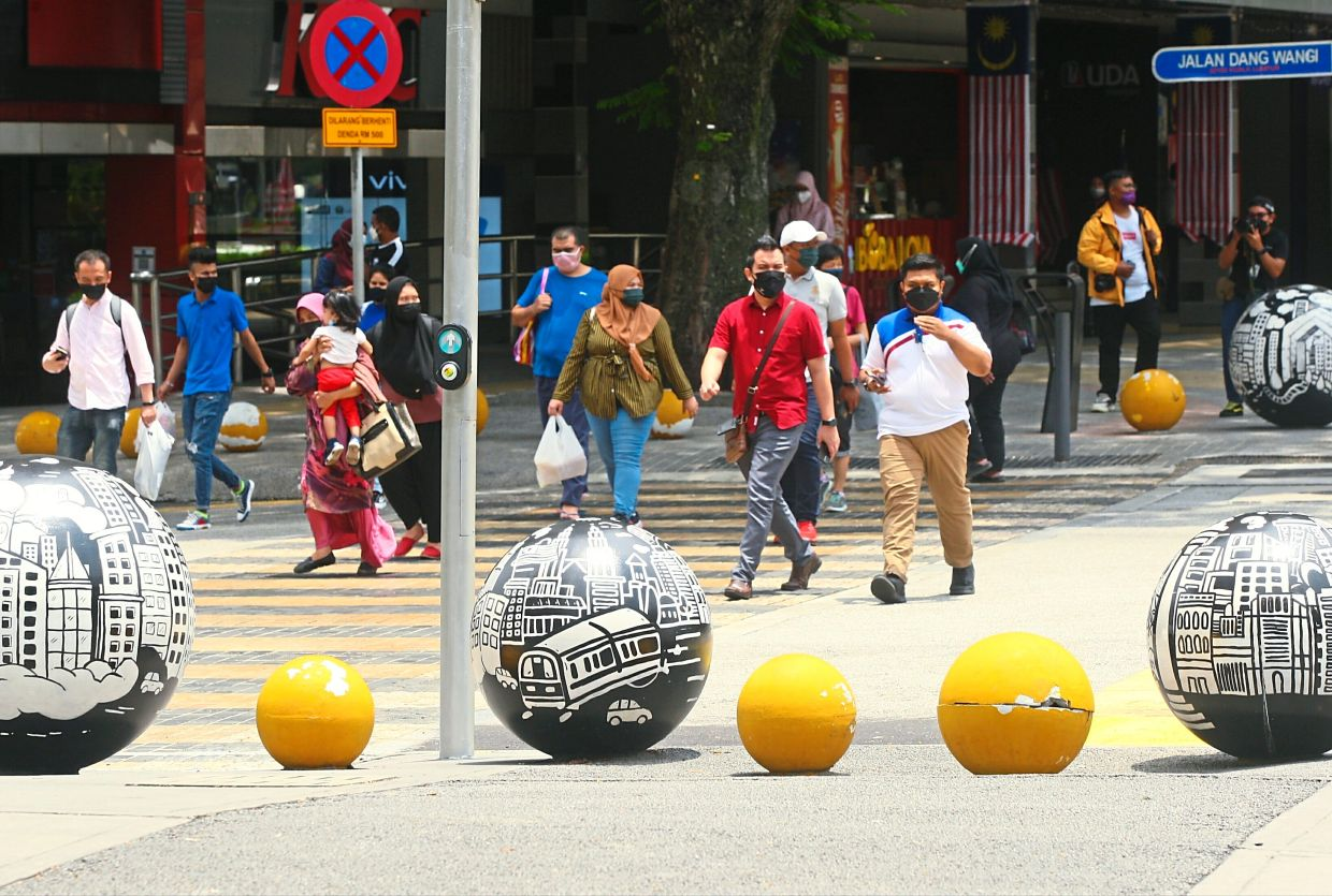 While most of the security bollards are damaged by vehicles that encroach upon walkways, there are passers-by who scratch and mar their surfaces. — AZMAN GHANI/The Star