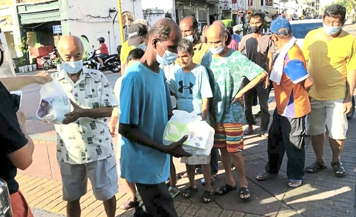 Aid being given out to poor people in George Town.