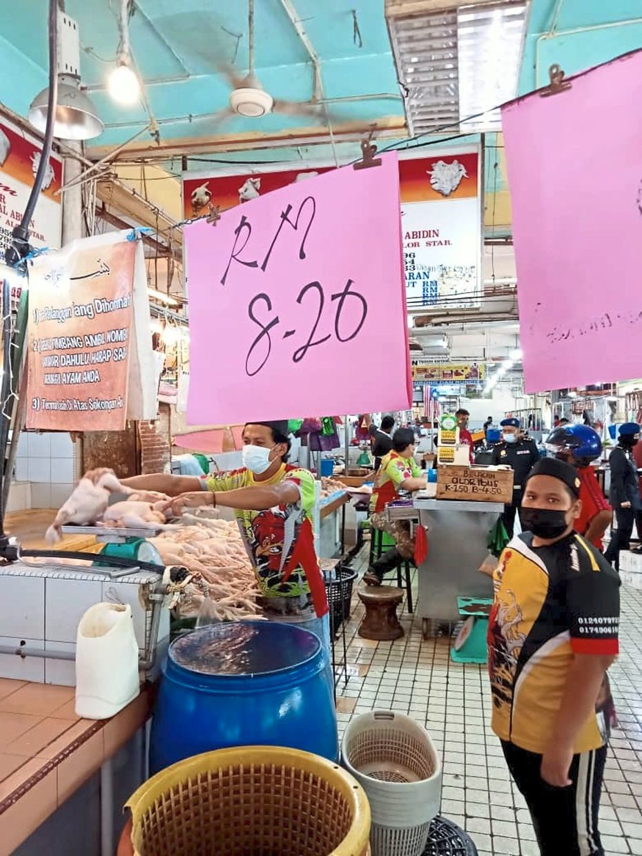 Standard chicken (cleaned) is sold at RM8.20 per kg at this wet market in Alor Star.