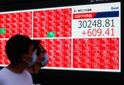 Japan jumps, rest of Asia down, on China and virus concerns