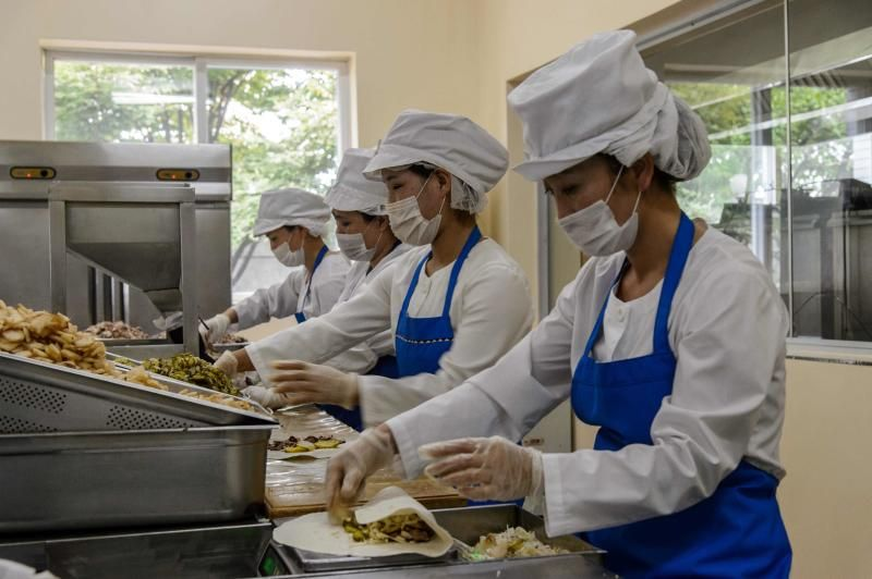 Employees produce wheat cakes stuffed with meat at the Kumsong Foodstuff Factory in Pyongyang on Friday (Sept 24, 2021). - AFP