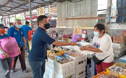 Mid-Autumn goodies for Pasir Pinji market traders, customers