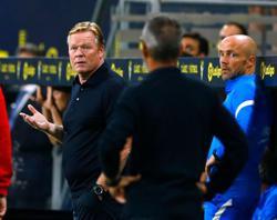 Soccer-Barcelona coach Koeman given two-match touchline ban