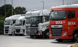 Long queues and fuel rationing as Britain faces truck driver shortage