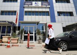More than 100 officials from Tunisia's Islamist Ennahda Party resign amid crisis