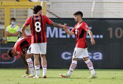 Soccer-Maldini scores on full debut as AC Milan go top with Spezia win