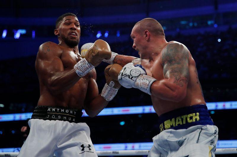 Boxing: Boxing-Usyk surpasses Joshua to claim world heavyweight titles