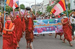 Monks march against military