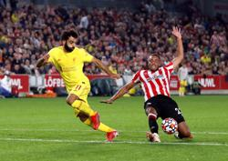 Soccer-Liverpool held to 3-3 draw by battling Brentford