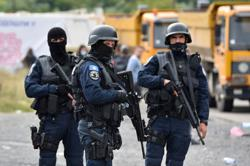 Kosovo says offices attacked in volatile north as Serbs block roads
