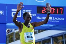 Athletics-Ethiopian Adola digs deep to win Berlin marathon, Bekele third