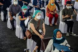 Logistics and staff shortage hurting Indonesia's vaccination progress