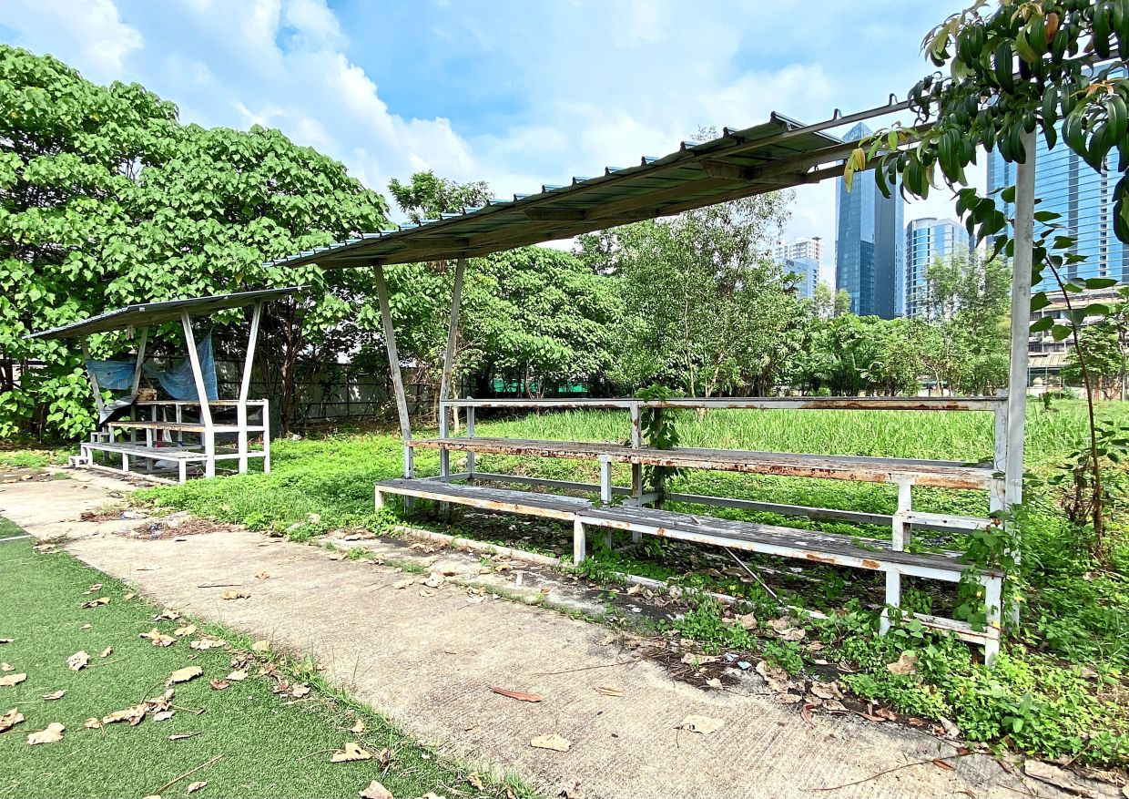 The spectators bench at Brickfields' Cruyff Court is falling apart.